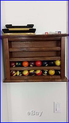 1920's Brunswick tournament 9' pool table with ball rack and neon signs