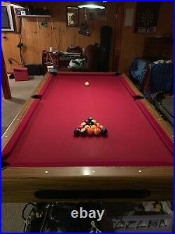 8 FT 3 piece slate pool table, comes with pool cues. Do not use it anymore