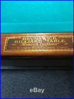 8ft brunswick pool table. Worth over $6000 comes with pool cues