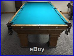 Antique Brunswick 8 foot Wellington pool table. Matching Littman LED light