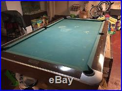 Antique Brunswick professional pool table with original balls and more