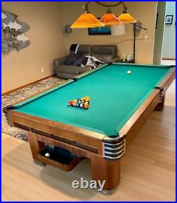 Brunswick Monarch Cushion 9' antique pool table with ball return. 3 piece slate