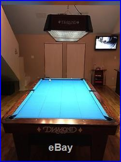 Diamond 9' one piece slate pool table with diamond wood rails