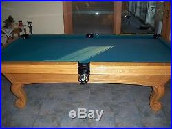 Pool table with cues, cue racks, balls, chaulk, granny
