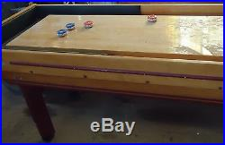 Vintage American shuffleboard table and accessories